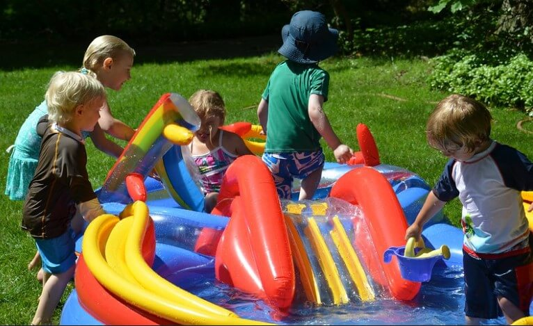 kids playing on kiddie pool